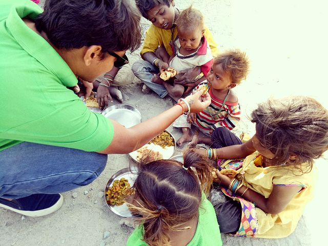 Man Eating with Young Children