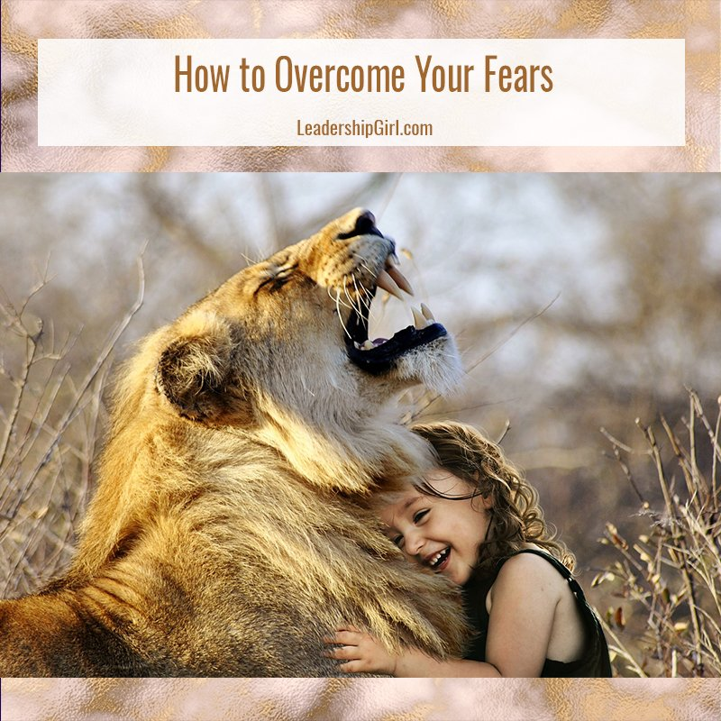 """How to Overcome Your Fears"" Young Girl Hugging Lion Graphic"
