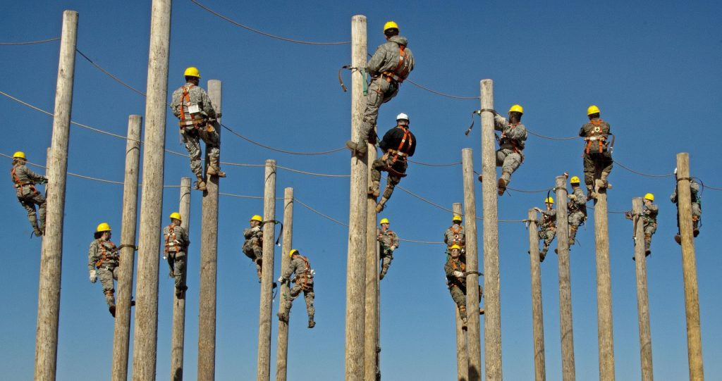 Utility Workers on Poles