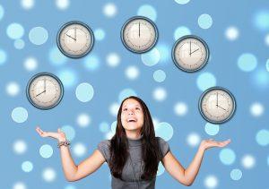 Woman Juggling clocks in the air