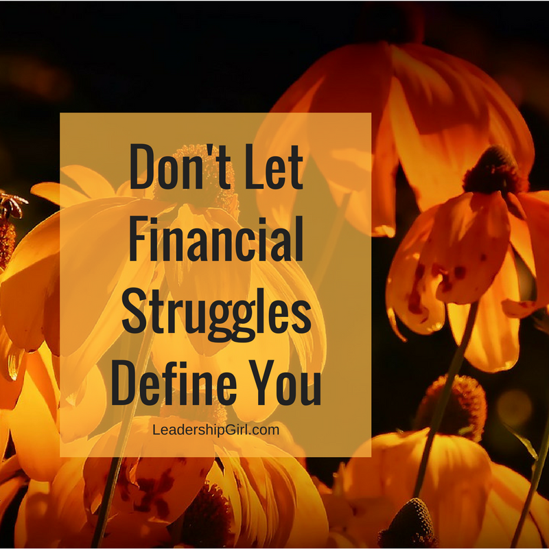"""Don't Let Financial Struggles Define You"" Orange Flowers Graphic"