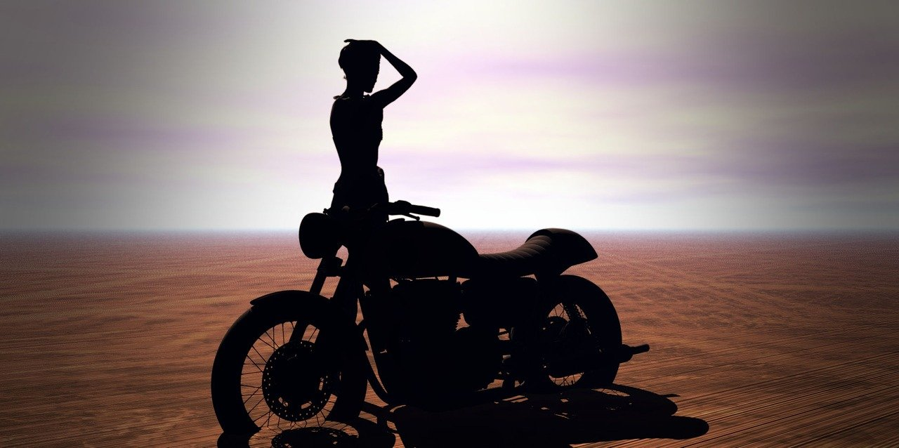 Woman on Motorbike in Desert