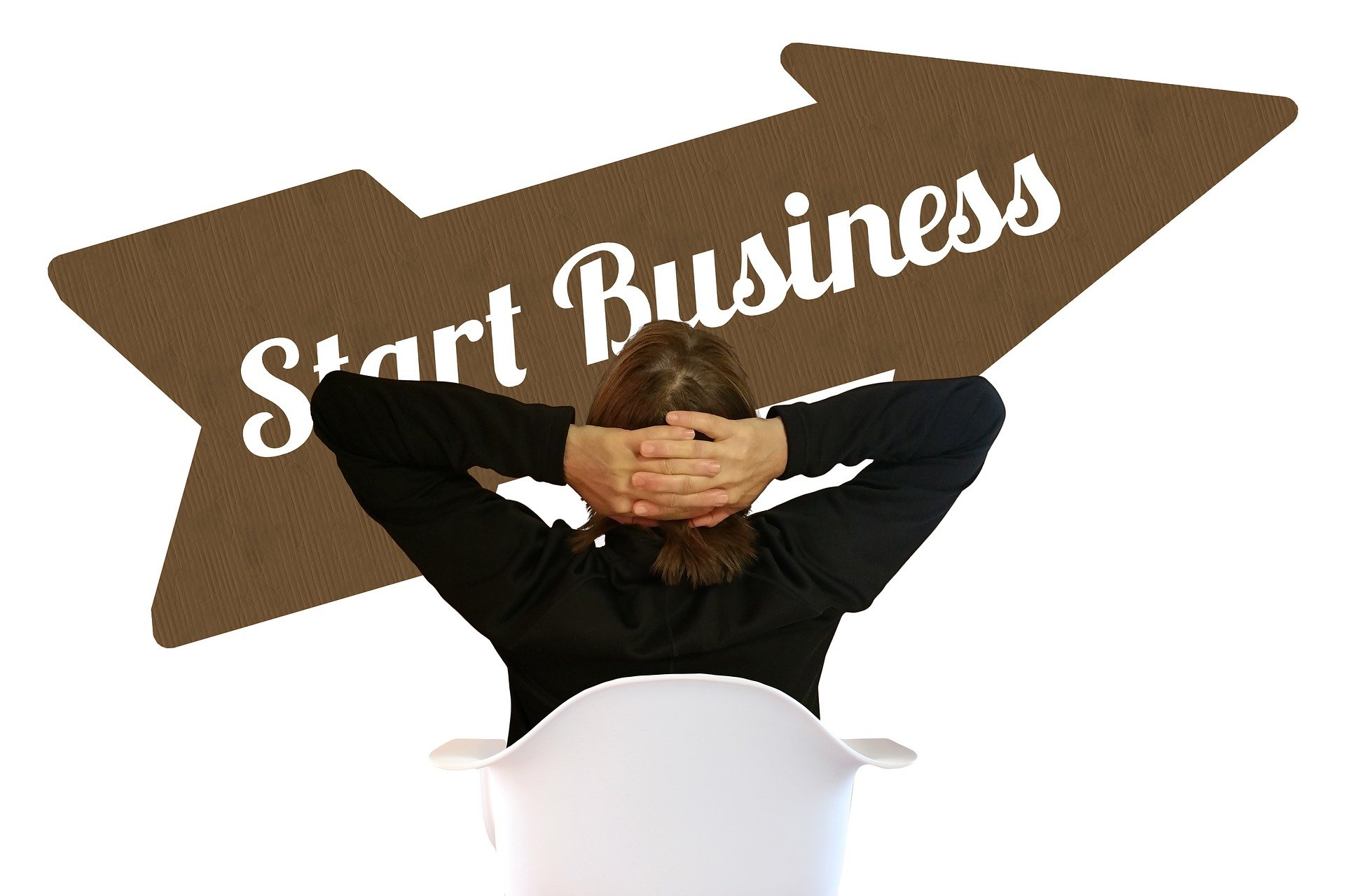 "Businessperson Staring at ""Start Business"" Arrow Graphic"