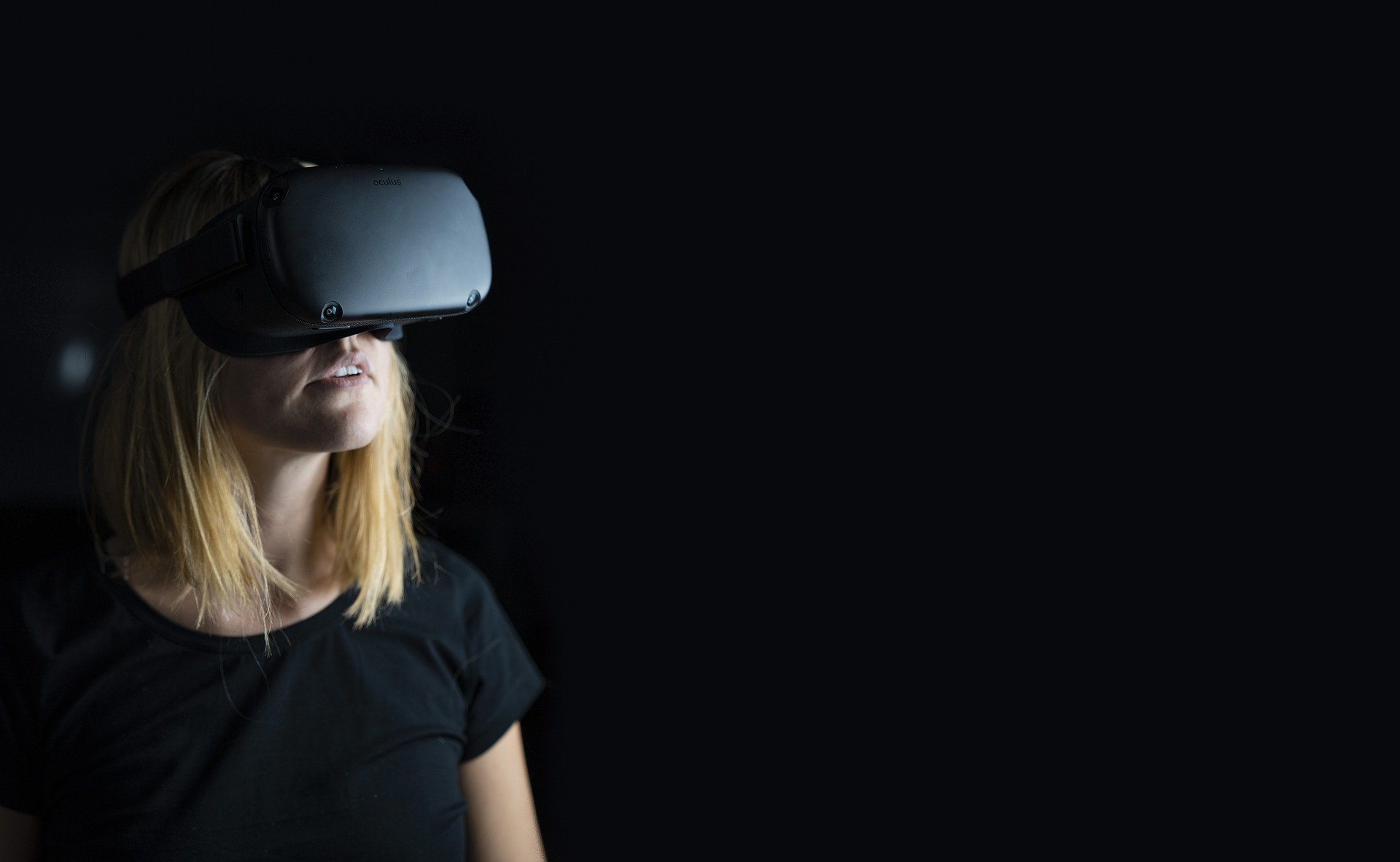 Woman with Virtual Reality Goggles on Black Background