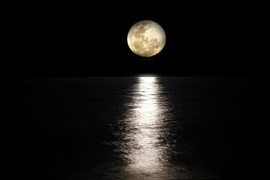 Moon in Dark Sky over Water