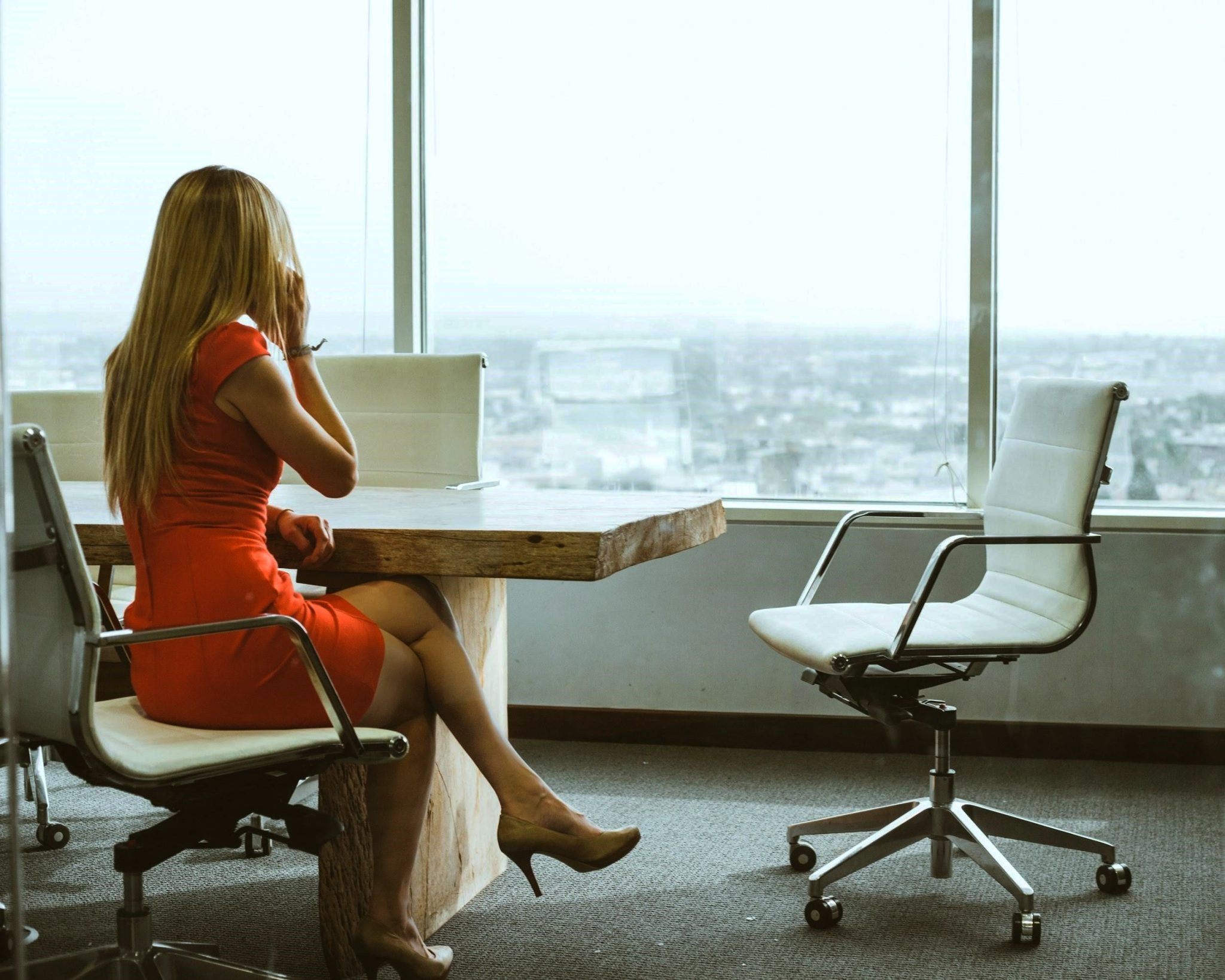 Successful Businesswoman at Meeting Table