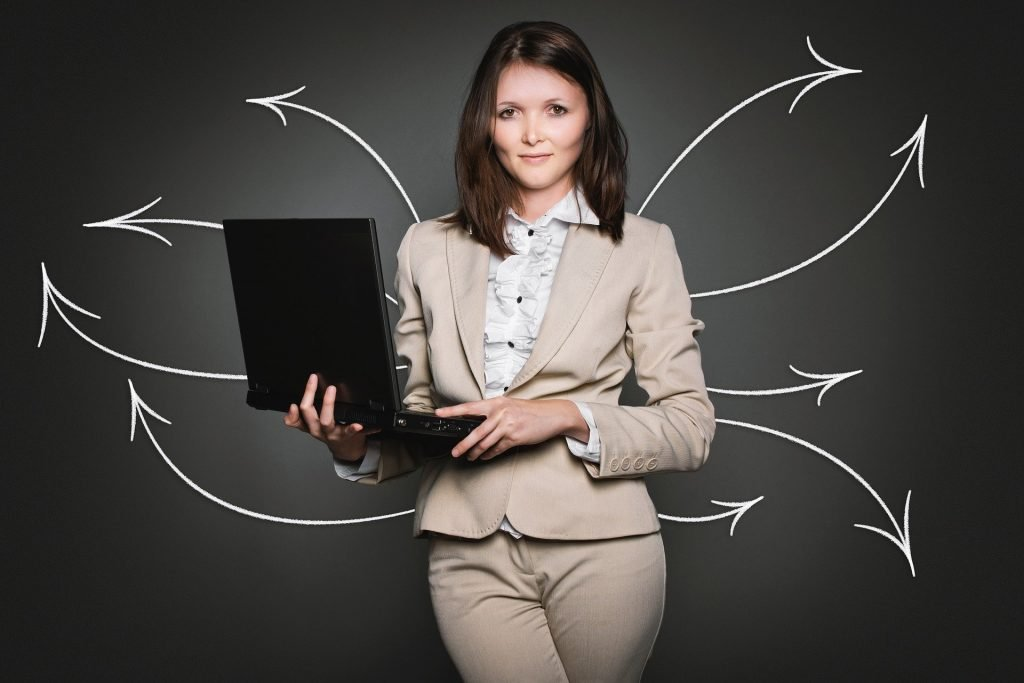 Businesswoman with Laptop and Arrow Graphics