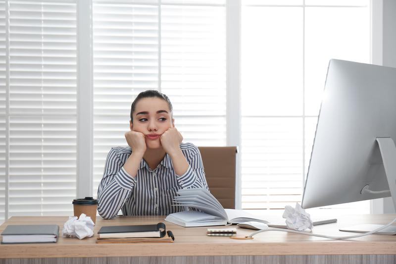 Frustrated Businesswoman at Cluttered Desk