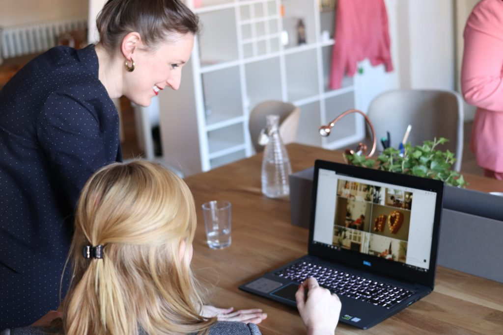 Businesswomen Talking at a Desk with Laptop